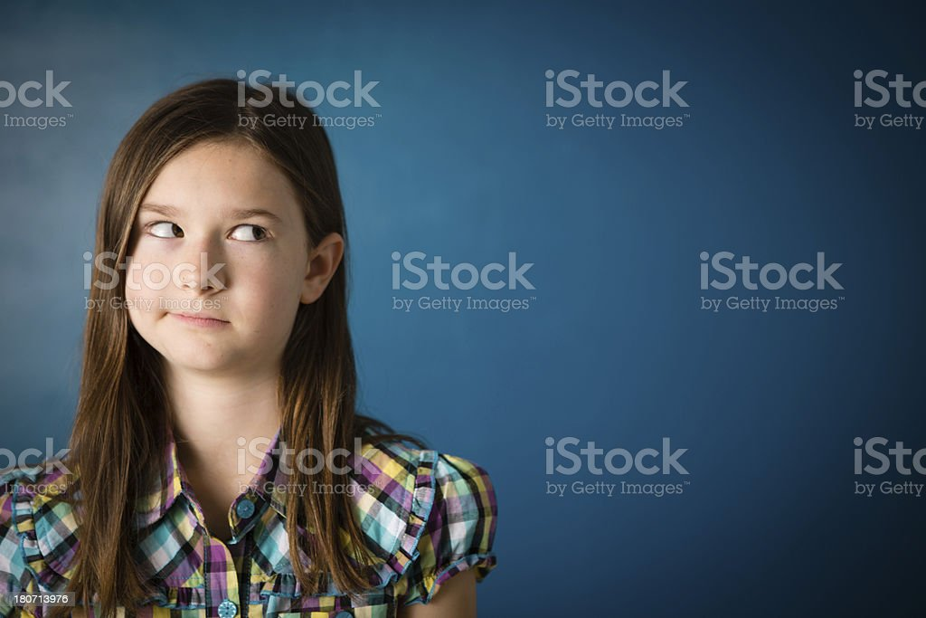 \'Color image of a young girl thinking, with blue background and room...