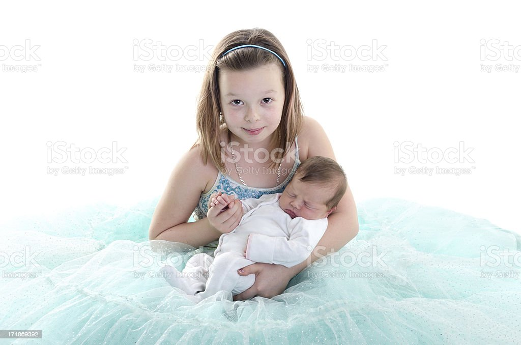 Nine year old holding baby sister's hand. royalty-free stock photo