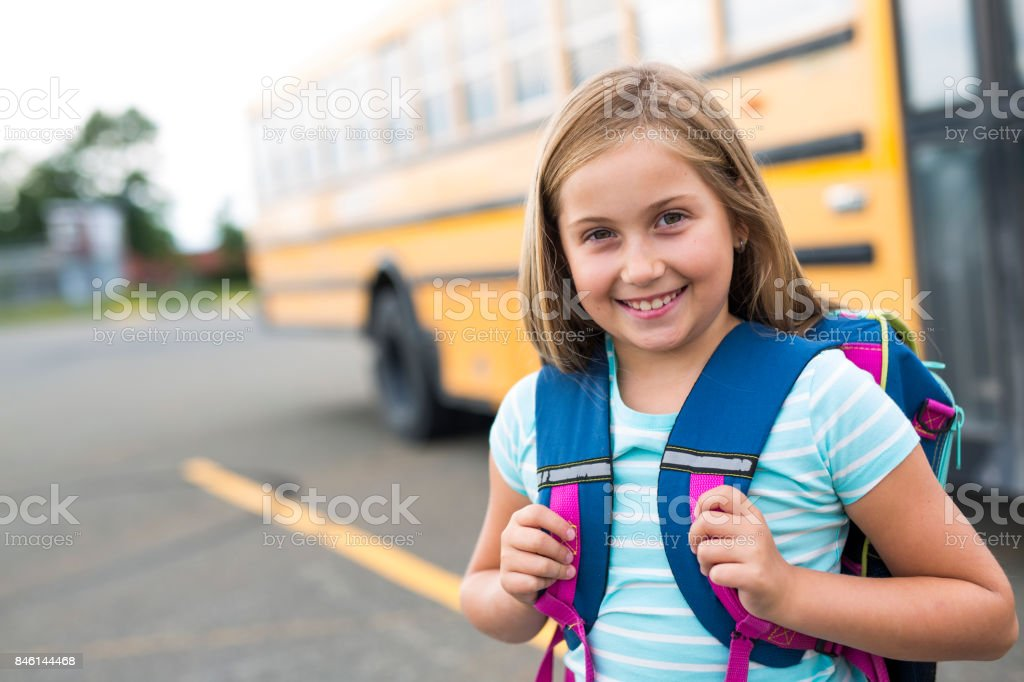 nine years old girl student at school stock photo
