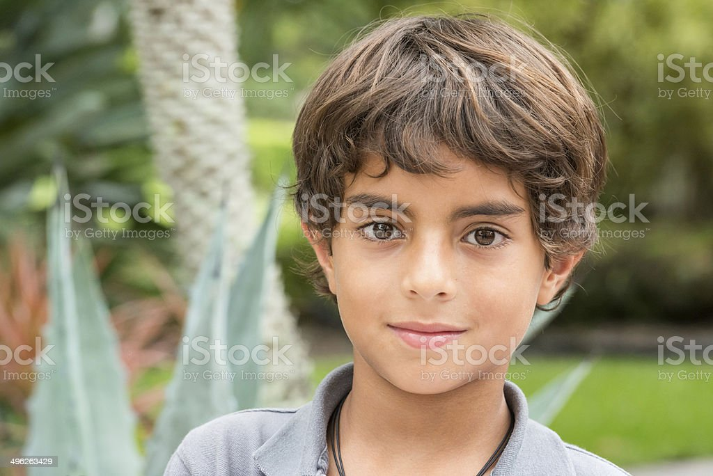 Nine years old little boy stock photo