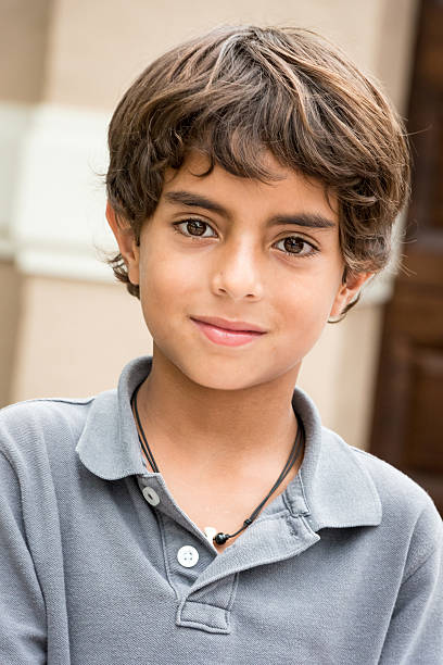 Nine years old little boy Hispanic nine years old little boy looking at the camera 8 9 years stock pictures, royalty-free photos & images