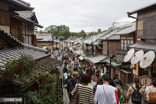 Kyoto, Japan - October 29, 2019 : People at Ninen-zaka. It is a stone-paved pedestrian road and tourist attraction in Higashiyama-ku, Kyoto, Japan.