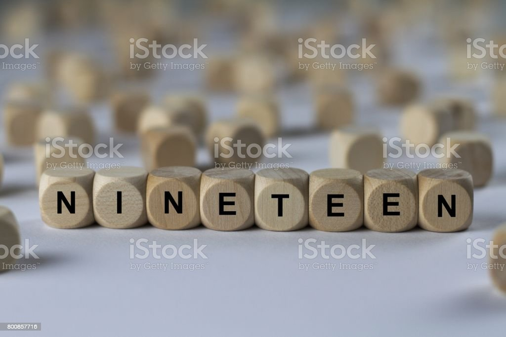nineteen - cube with letters, sign with wooden cubes stock photo