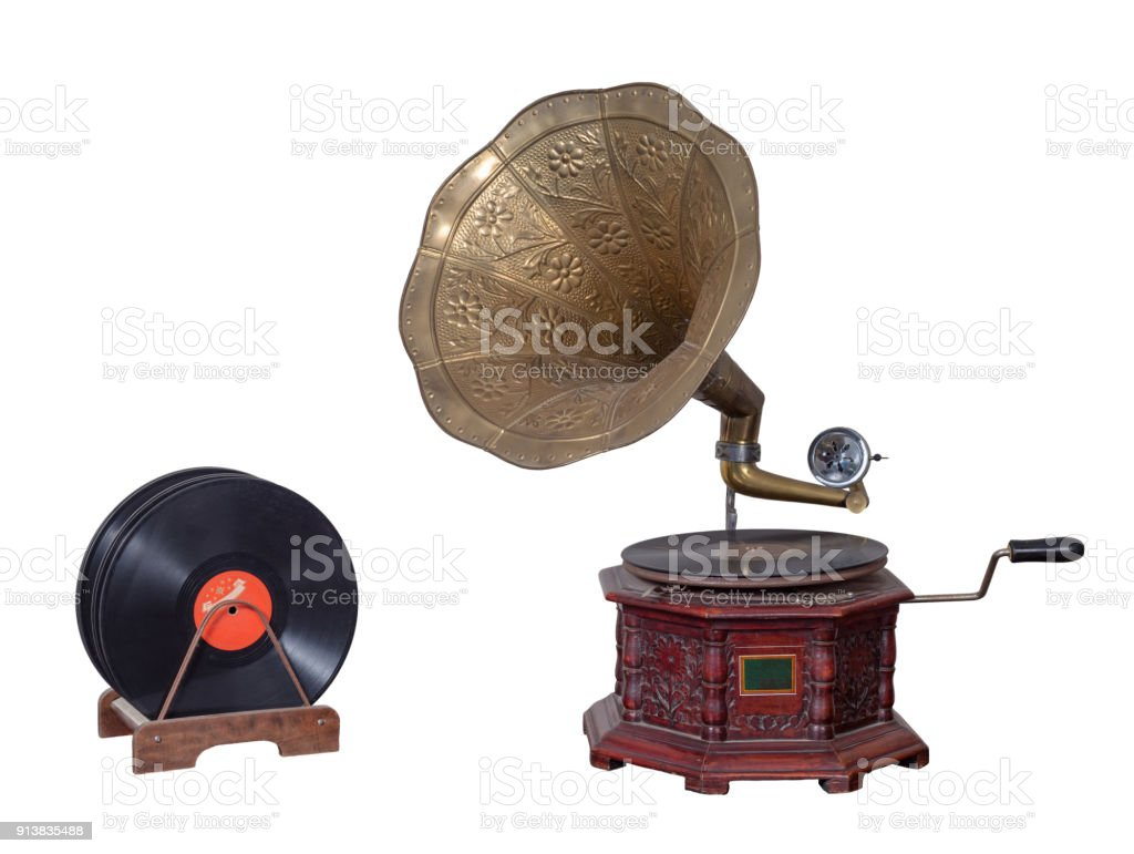 Nineteenth century phonograph (gramophone) and vinyl records isolated on white including clipping path stock photo