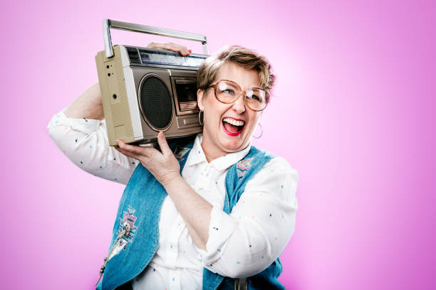 nineties styled woman portrait with boombox stereo - 1990s style stock photos and pictures