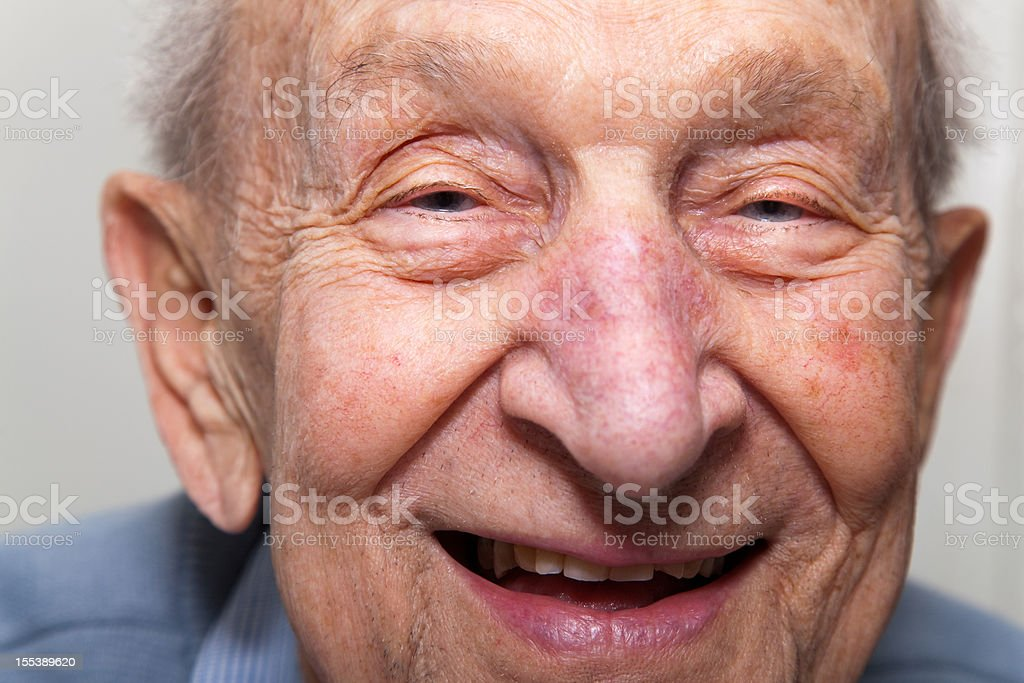 Ninety year old senior man laughing close up stock photo