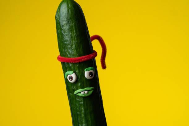 Ninja cucumber with red headband stock photo