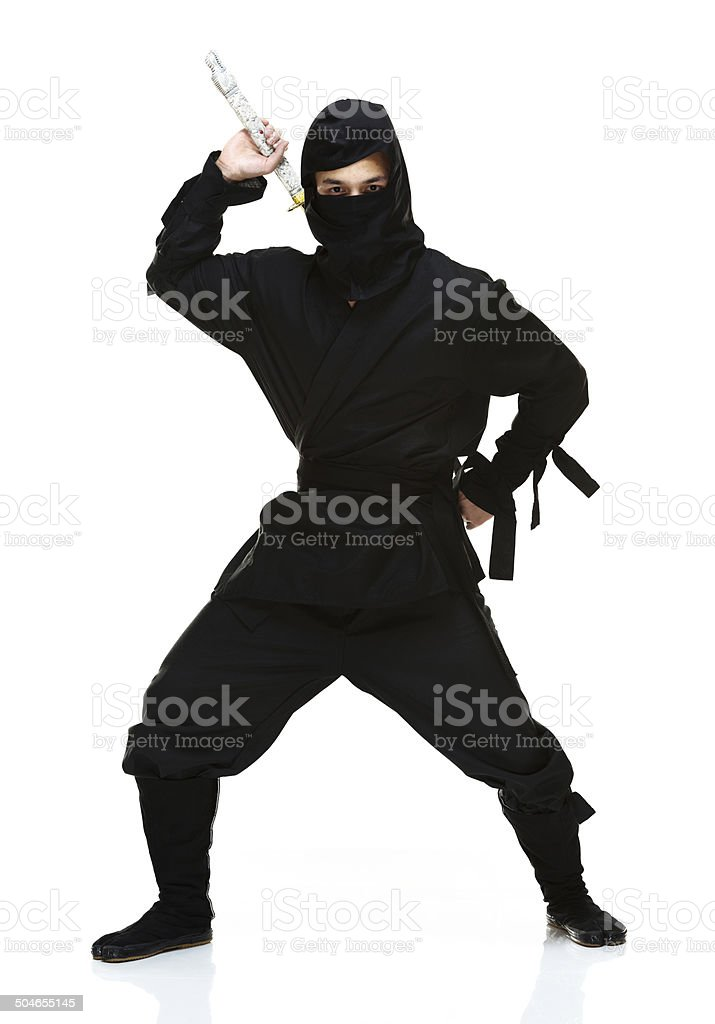 Ninja in action & looking at camera stock photo