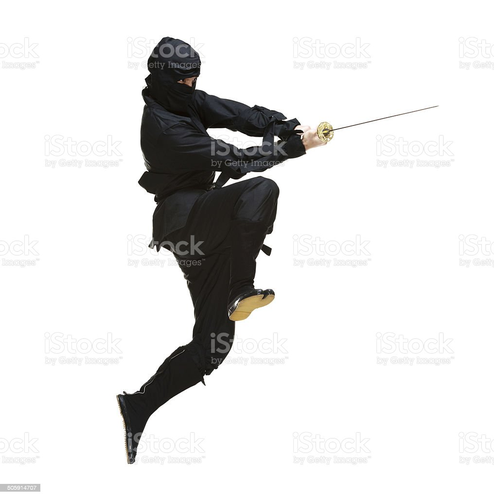 Ninja in action with sword stock photo
