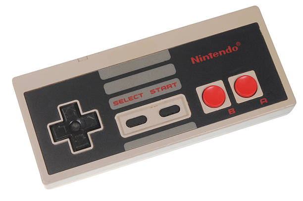 Nintendo Entertainment System (NES) Controller Adelaide, Australia - February 23, 2016: A studio shot of a Nintendo Entertainment System (NES) Controller. A popular 8-bit entertainment system sold worldwide during the 1980's. nintendo stock pictures, royalty-free photos & images