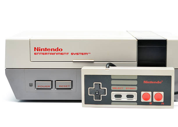 Nintendo Entertainment System Vancouver, B.C., Canada -- January, 14, 2015:Closeup of an old Nintendo Entertainment System and Controller from the 1980s on a white background. nintendo stock pictures, royalty-free photos & images