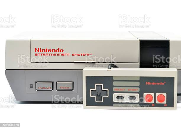Vancouver, B.C., Canada -- January, 14, 2015:Closeup of an old Nintendo Entertainment System and Controller from the 1980s on a white background.