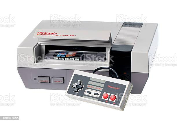 """""""Taipei, Taiwan - July 4, 2012: This is a studio shot of a Nintendo Entertainment System including a controller and game cartridge, made by Nintendo Co. isolated on a white background."""""""