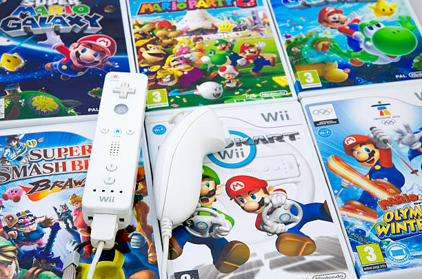 Nintendo Mario Wii Utrecht, The Netherlands - March 17, 2011: a Nintendo Wii Remote and Nunchuck on six different Mario Wii games. nintendo stock pictures, royalty-free photos & images