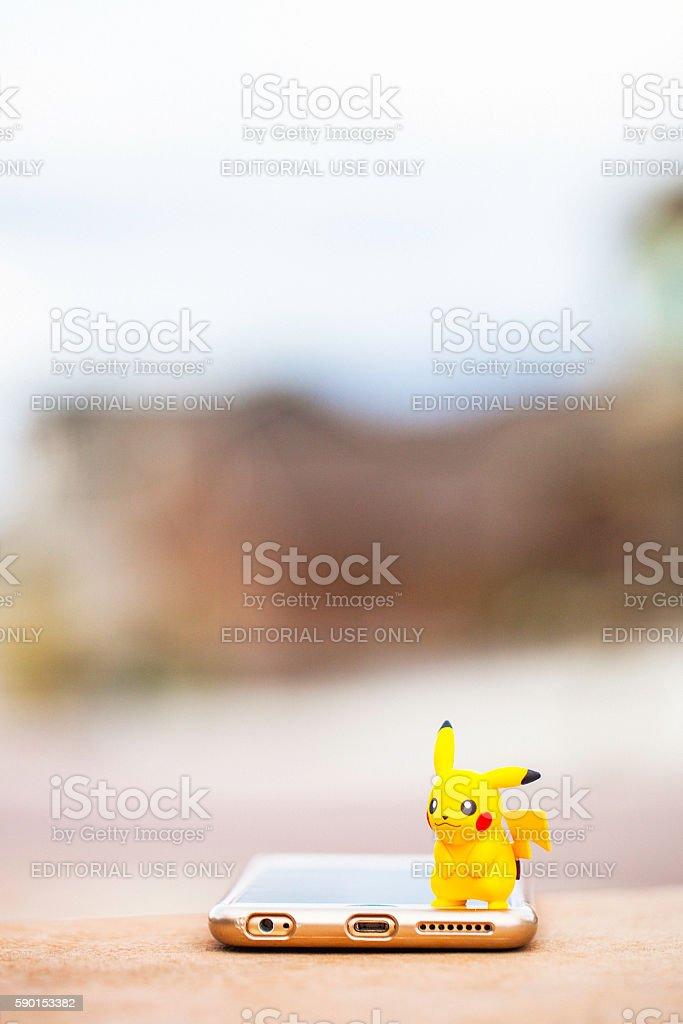 Nintendo Pokemon Go character Pikachu and iPhone stock photo