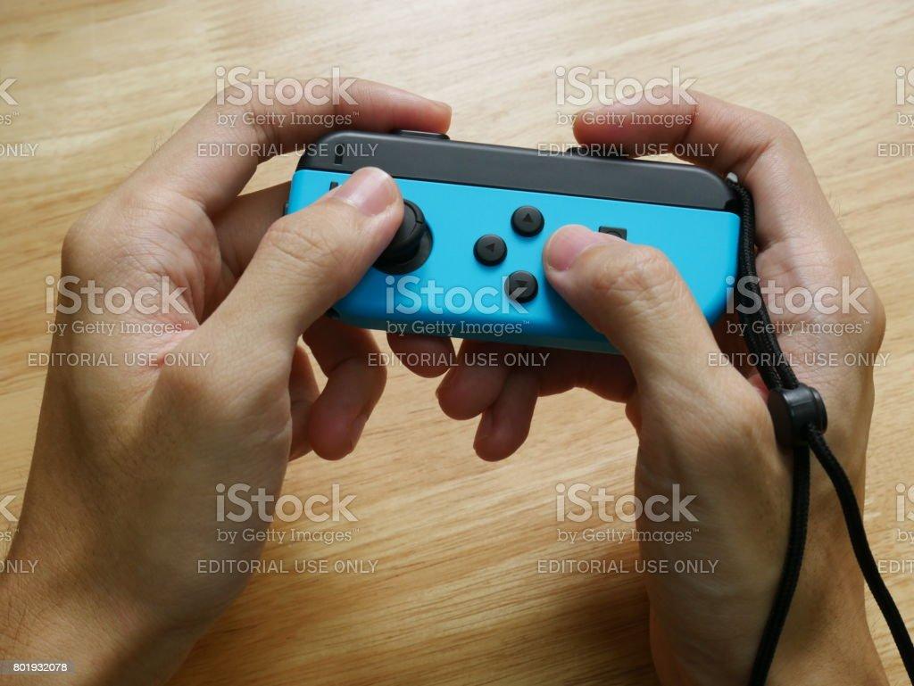 Bangkok, Thailand - June 25, 2017 : Nintendo Switch controller held in hand. stock photo