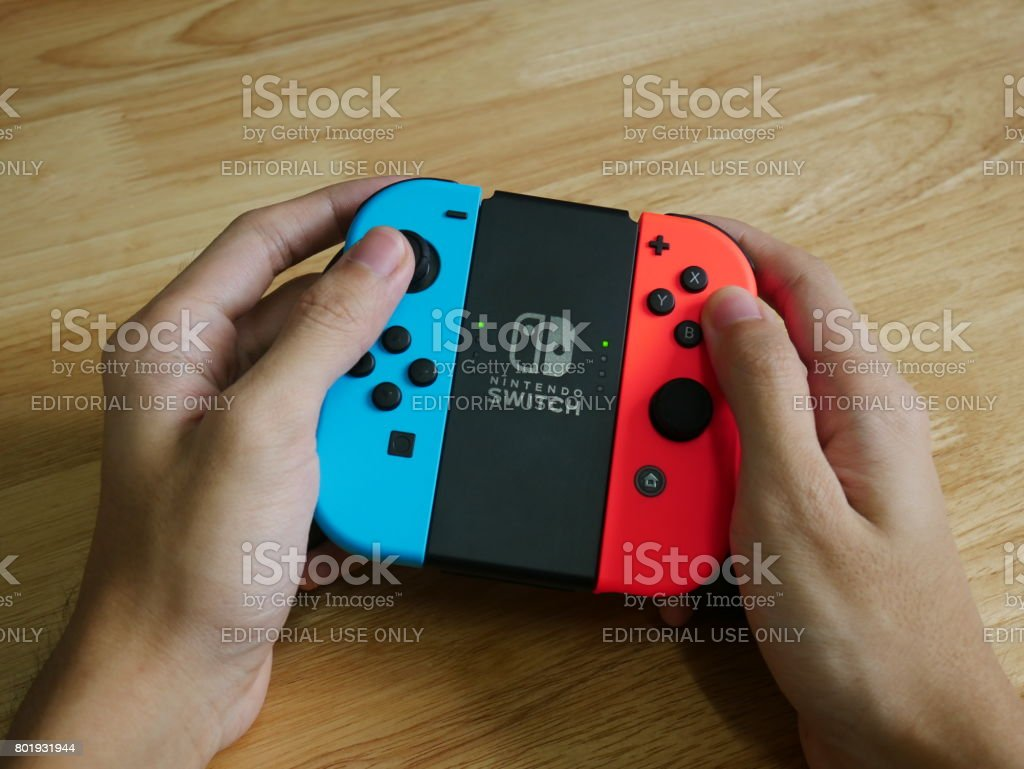 Bangkok, Thailand - June 25, 2017 : Nintendo Switch controller held in hands. stock photo