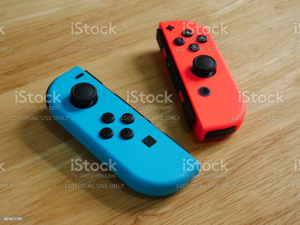 Bangkok, Thailand - June 25, 2017 : Nintendo Switch controllers on wooden table. stock photo