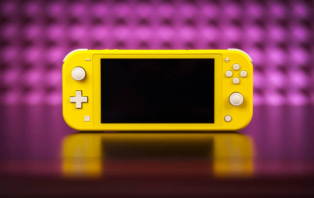 Nintendo Switch Lite is Nintendo's latest entry into handheld gaming. Priced at $199.99, the Switch Lite is available in yellow color MOSCOW, RUSSIA - October 08, 2019: Nintendo Switch Lite is Nintendo's latest entry into handheld gaming. Priced at $199.99, the Switch Lite is available in yellow color nintendo stock pictures, royalty-free photos & images