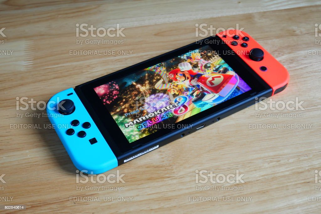 Bangkok, Thailand - June 26, 2017 : Nintendo Switch showing its screen with Mario Kart 8 Deluxe game. stock photo