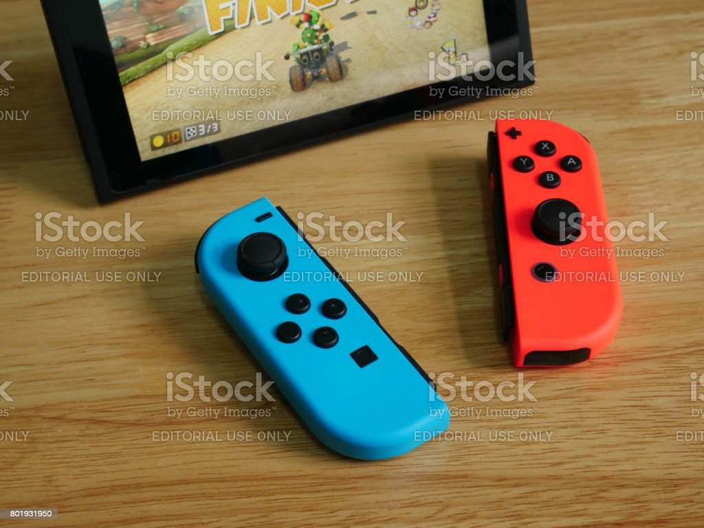 Bangkok, Thailand - June 25, 2017 : Nintendo Switch, the video game console on wooden table. stock photo