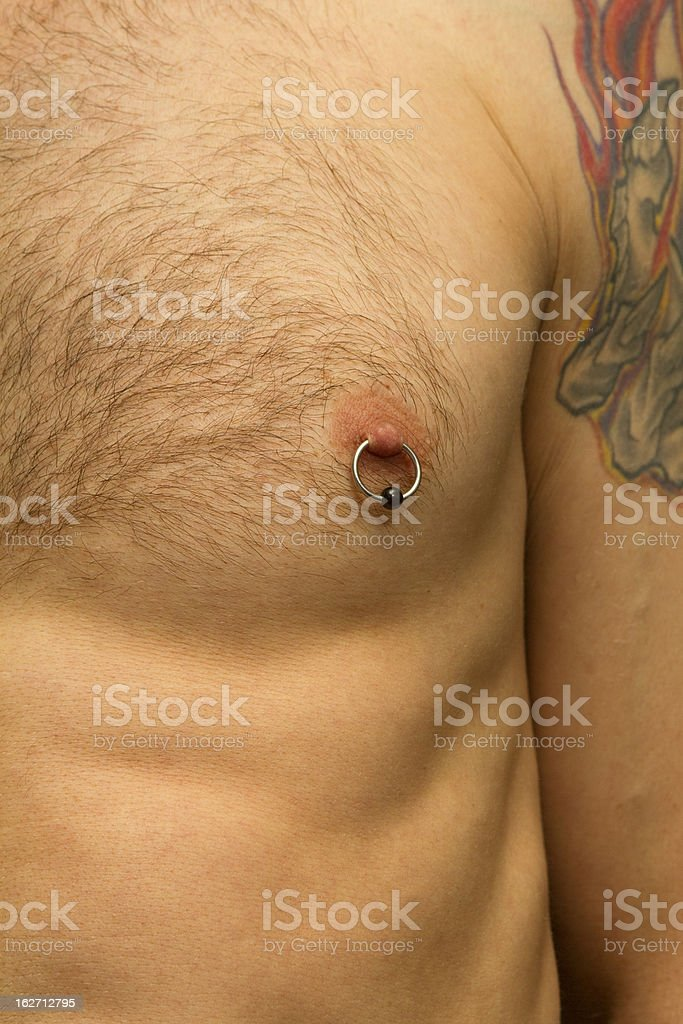 Nipple Piercing and Tattoo stock photo