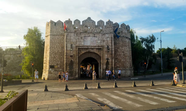 nis fortress entrance with people waiting in the traffic light at sunset - serbia stock photos and pictures