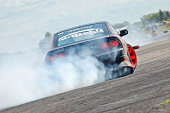 """""""Kedainiai, Lithuania - May 9, 2009: Drift parctise event at Kedainiai drift track (abandoned air field) where anybody had opportunity to improve their drifting skills.. Here is Nissan RPS13 skidding with lots of smoke in a high speed U turn."""""""
