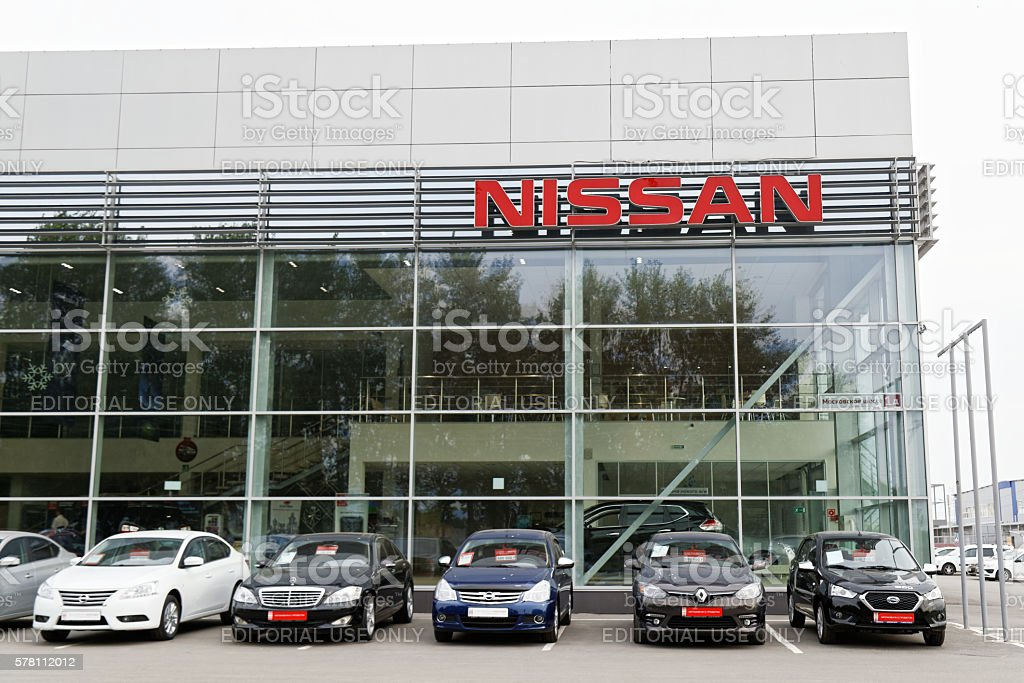 Nissan car selling and service center with Nissan sign. – Foto