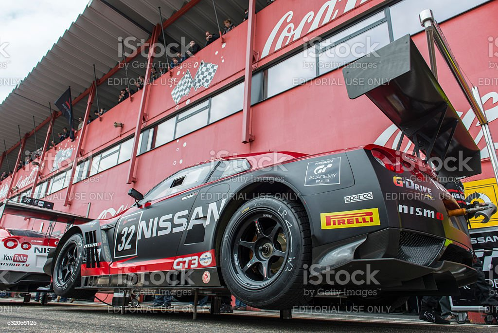 Nissan GT-R Nismo GT3 race cars in the pit lane stock photo