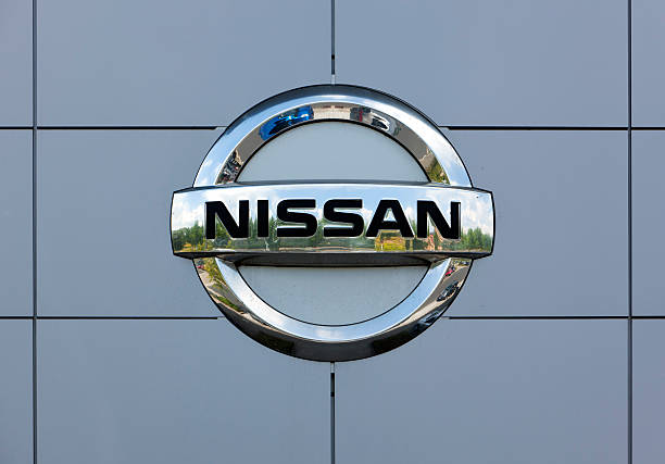 Nissan logo on wall of car dealer's building stock photo