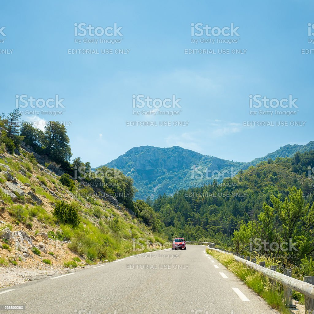 Nissan Micra car on background of French mountain nature landscape stock photo