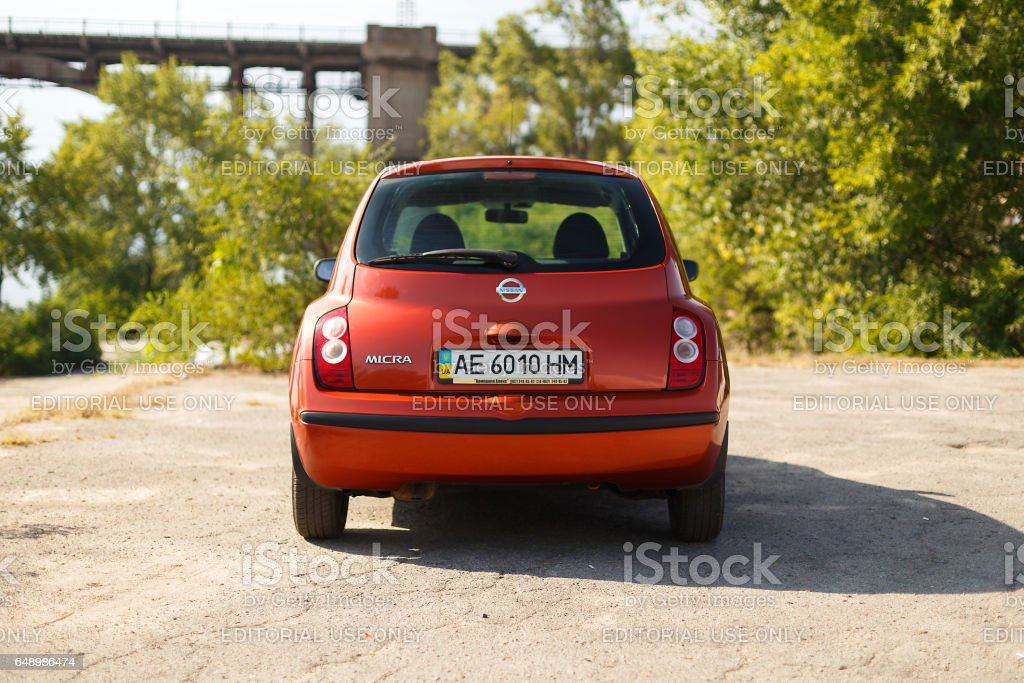 Nissan Micra near the river in the city stock photo
