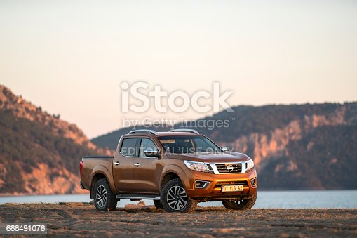 Nissan NP300 Navara stopped on the beach near Dalaman, Turkey. The newest generation of Navara was debut in 2015 on the market. The Navara is powered by 2,3-litre diesel engine and 190 HP