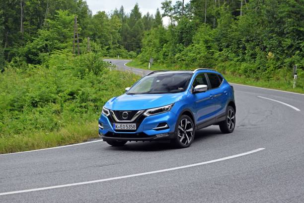 Nissan Qashqai in motion Vien, Austria - June, 26. 2017: Second generation of Nissan Qashqai (after facelifting) driving on the road. The Qashqai is the most popular SUV/crossover on the European market. 2017 stock pictures, royalty-free photos & images