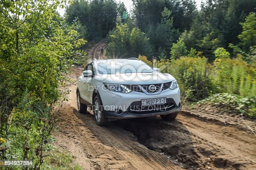 Minsk, Belarus - September 12, 2017: Nissan X-Trail drives off the road in the sand during a test-drive event. X-Trail is a mid-size city SUV equipped with an all-wheel-drive transmission.