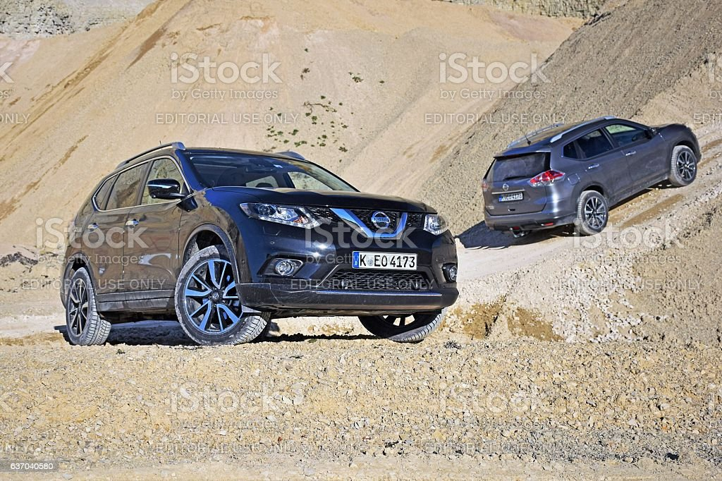 Nissan X-Trail vehicles on the unmade road stock photo