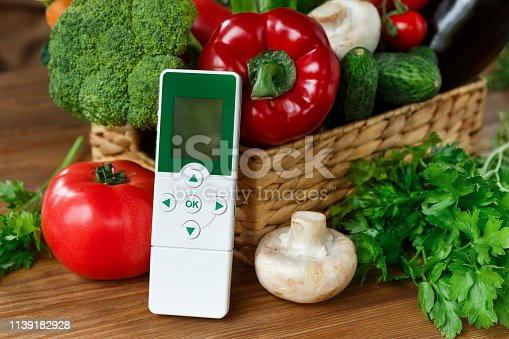 927641110 istock photo Nitrate tester and various vegetables on wooden background 1139182928