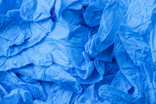 Nitrile Gloves Pile of blue nitrile gloves surgical glove stock pictures, royalty-free photos & images
