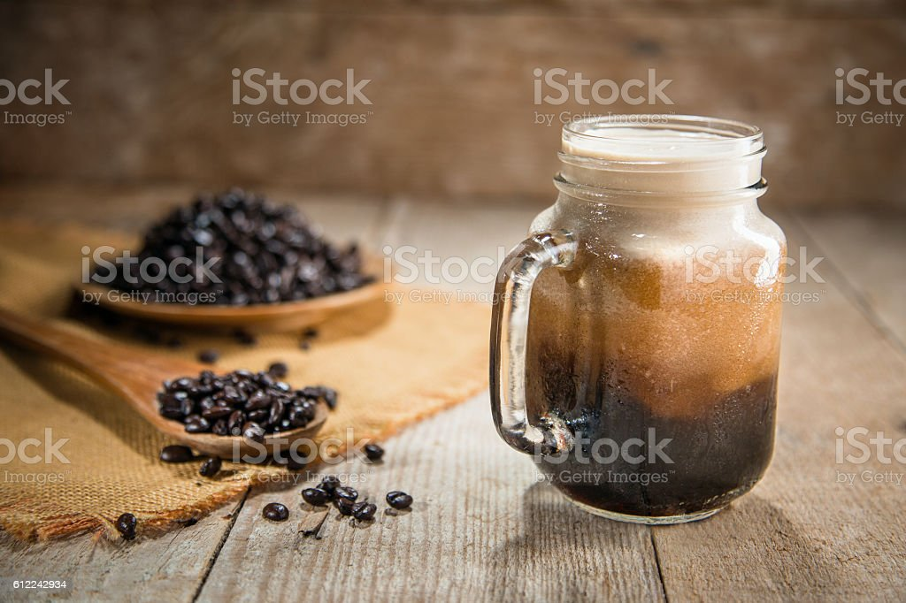 Nitro coffee fresh pour tap rustic lifestyle espresso mocha beans stock photo