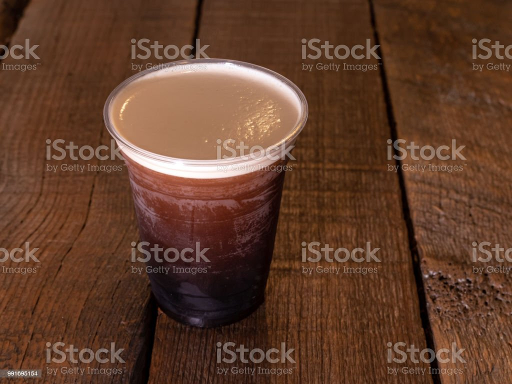 Nitro Cold Brew Coffee beverage on a rustic wood background. stock photo