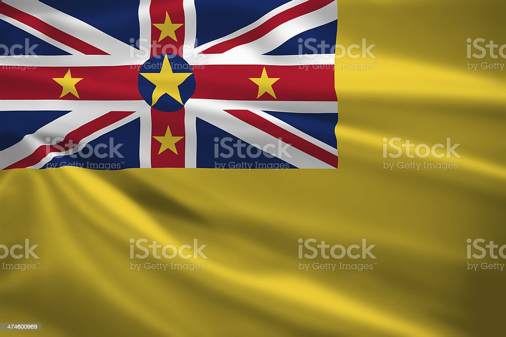 Niue flag blowing in the wind stock photo