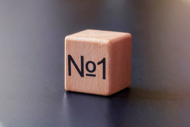 No 1 printed on the side of a wooden toy block stock photo