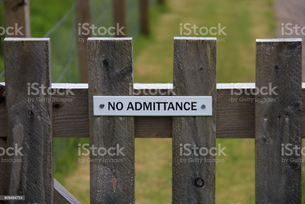 No Admittance sign fixed to a wooden gate stock photo