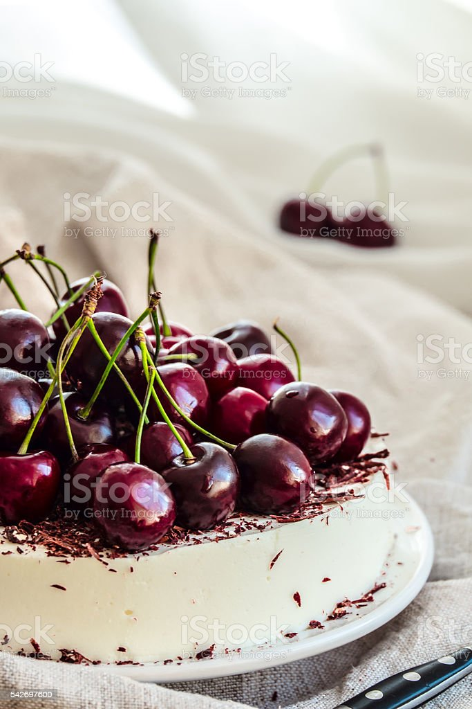 No bake vanilla cheesecake mousse with cherries and chocolate stock photo