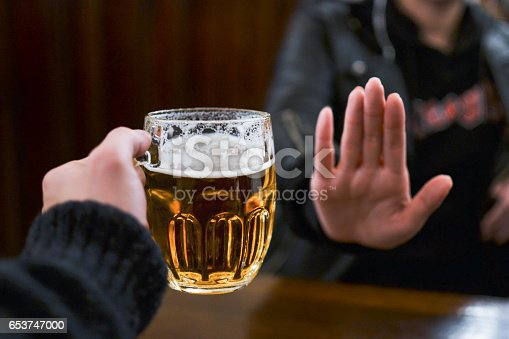 istock No beer and alcohol. Addiction. Stop drinking. 653747000