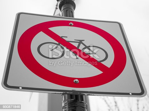 istock No bicycle sign with a grey sky on background 930871846
