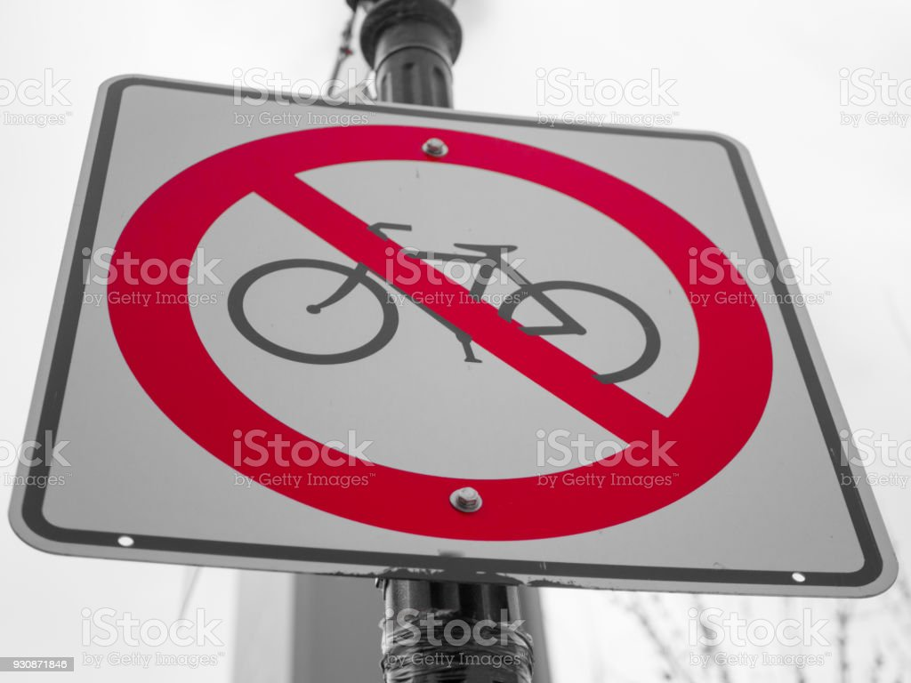 No bicycle sign with a grey sky on background stock photo