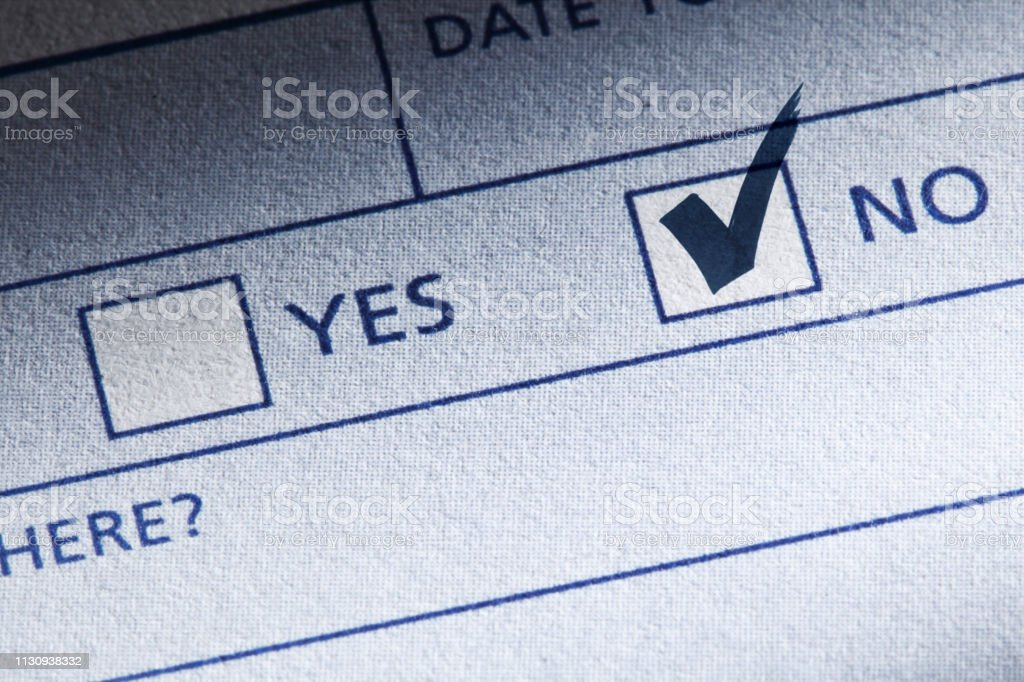 A box marked \'no\' is checked with a bold checkmark on a questionnaire...