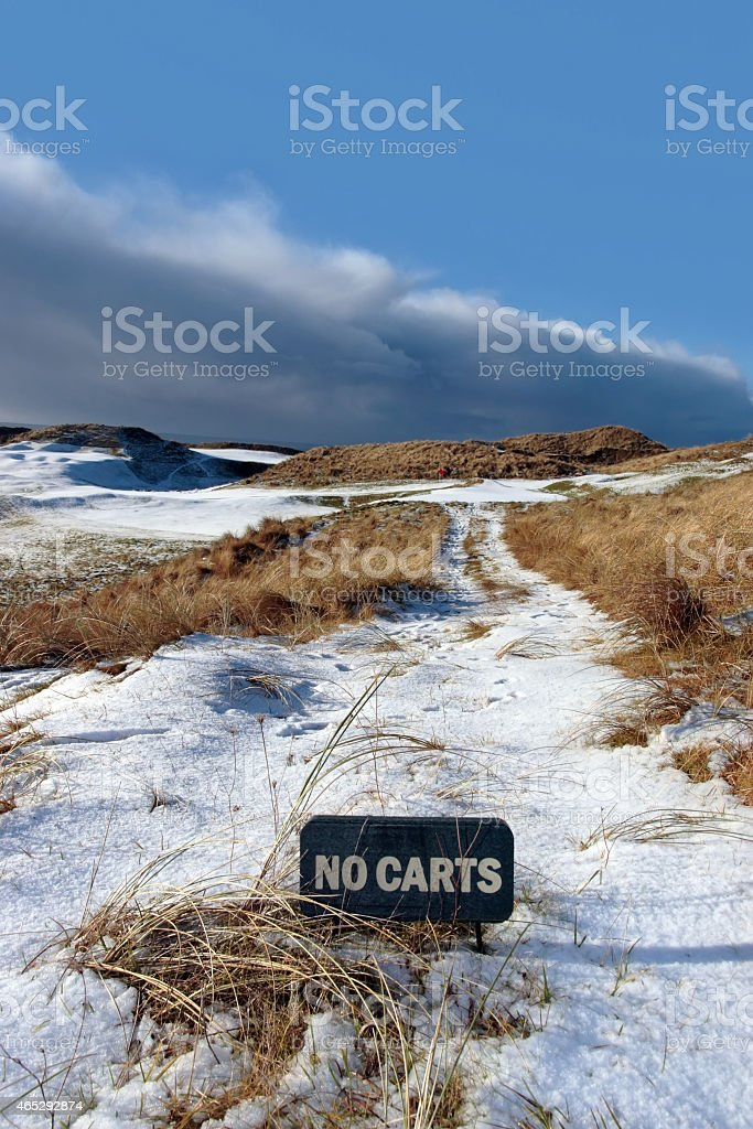 no carts sign on a snow covered links golf course stock photo